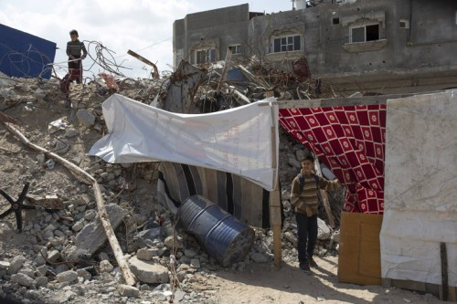 <p> Children of the family of Suleiman Abu Darouj walk near the ruins of their destroyed home in Zawaydeh village, Gaza Strip, March 17, 2015. Five members of the family were killed during the Israeli 2014 offensive, of whom two children. Six months after the ceasefire over 100,000 Palestinians are still displaced.</p>
