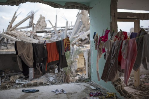 <p> Clothes are hung in a half destroyed home in the quarter of Al Shaaf area, Al Tuffah, east of Gaza City, March 21, 2015. Six month after the ceasefire that ended the Israeli 2014 summer offensive, 100,000 Palestinians are still displaced and many live in dire conditions. Rebuilding materials are scarce as the Gaza Strip face restrictions imposed by Israel.</p>
