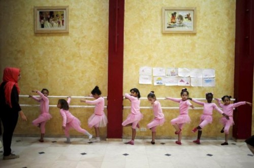 Palestinian girls take part in a ballet dancing course, run by the Al-Qattan Center for Children, in Gaza City